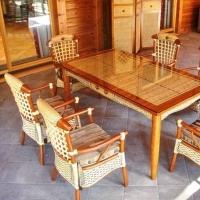 Терраса загородного дома в Подмосковье. Мебель из натурального ротанга
